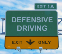 defensive driving hwy sign